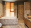 卧室旁边的卫浴室,采用全木色瓷砖和大理石