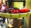 精致的东南亚风格陶瓷餐具有浅褐色、翡翠绿的自由搭配和瓷面略带冰裂感的晶莹光泽,可为厨房增添东南亚热带风情