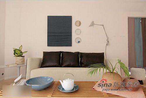 米色的布艺沙发,有着柔软的质感和简约的