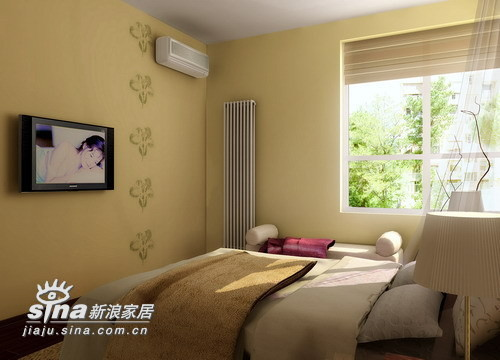 电视旁边的几朵花使米黄墙体墙体不再单调使卧室带有了灵气