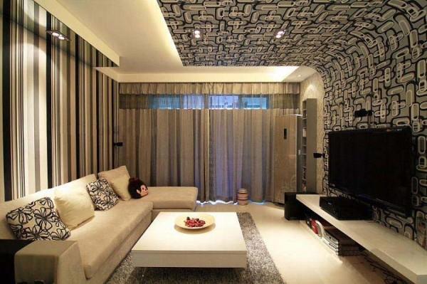电视背景墙黑白花式的延伸处理恰到好处,对置的沙发后置背景墙颜色选择同一色调,采用同种色系而不同花式的处理方法,尽显现代简约风