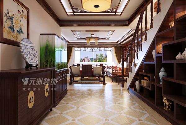 门厅及楼梯间:在原有的基础上把楼梯扩宽了,利用楼梯间一分为二外面作为中式多宝阁,后面实际上是储物间,地面采用拼花处理,显得华丽大方