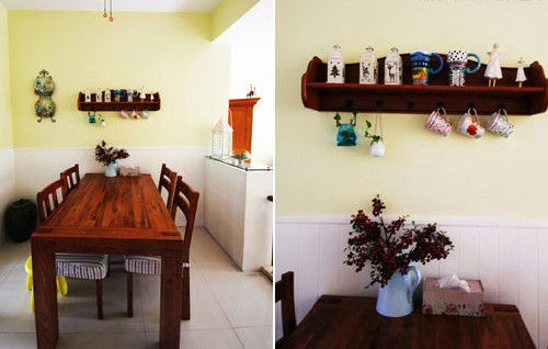 装饰亮点:淡黄色的墙面清新感十足,乡村风格的长实木餐桌(餐桌装修效果图),俏皮可爱的瓷器餐具和条纹布艺搭配,明亮的色彩和图案组合像春风一样柔和自然,加上早春的几枝鲜花点缀,让餐桌有了更多情调。