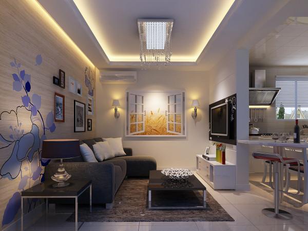 客厅白色的墙面配上黑色的沙发,整体简约时尚;沙发背景墙悬挂的艺术照,给空间增添了艺术感