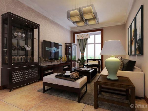 典型的中式电视柜,茶几与沙发,巧妙的搭配瓷砖的色泽。