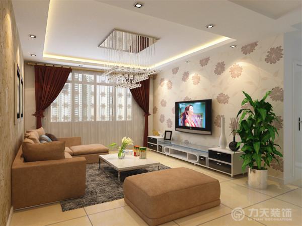 沙发用咖色布纹与抱枕进行对比,墙面用两幅黑白现代画来装饰