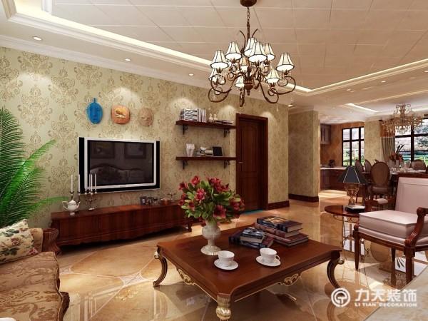 客厅采用的电视背景墙,吊灯,小茶几,彰显欧洲品味