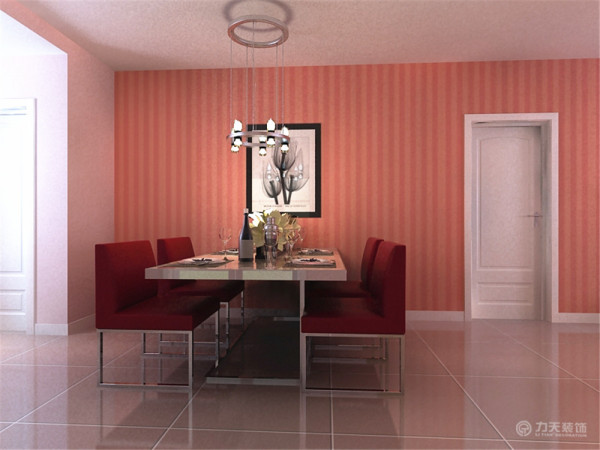 餐厅区域还算是独立的空间,因为要留有过道,所以就靠墙摆放了一套现代感极强的不锈钢和布艺结合的四人餐桌,布艺颜色用的是和整体空间相呼应的红色,非常的简洁时尚,节省了空间方便主人来回走动