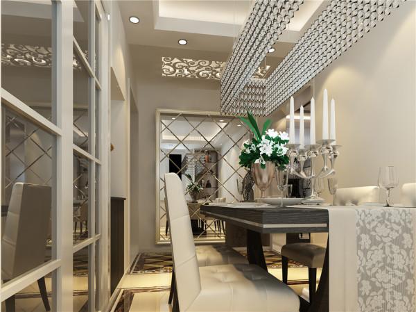 占据大面积的银灰色绒面沙发柔软奢华,和线条硬朗明快的深色木质电视柜、茶几一起玩味混搭客厅正对着的是茶室的玻璃推拉门,深色玻璃上描绘着白色抽象图案,艺术美感不言而喻。