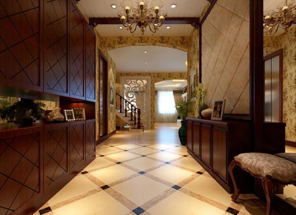 设计理念:该空间运用大量的石材和木饰面装饰,在软装摆设上选用仿古艺术品,已精致细 腻的细部工艺凸显空间的品质和价值。使田园风格的门厅宽敞且富有历史气息。