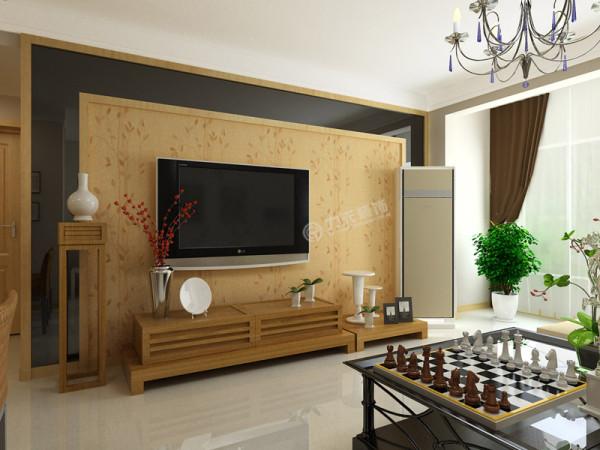 电视背景墙为米黄色,茶几为黑色。