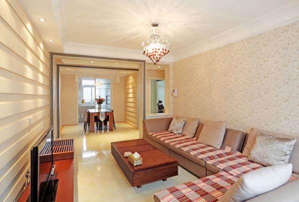 在客厅电视背景墙同样采用中膏板造型,与餐厅形成呼应,同时使得客厅空间得以延伸。