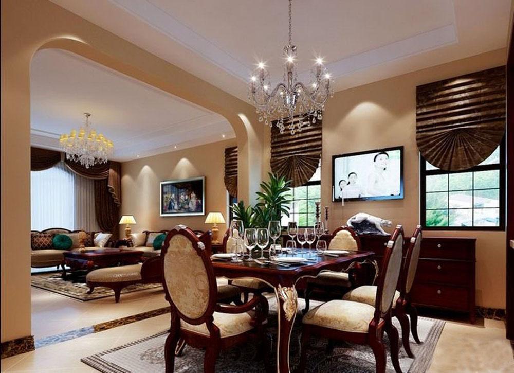 客厅和餐厅本身是连通的结构,中间有横梁,我们通过拱形的垭口设计,将