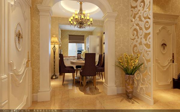 厨房做成开放式的餐桌椭圆形的,欧式典型的拱形门造型,将厨餐厅跟入户门有机的区分开。