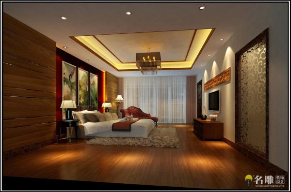 名雕装饰设计——主卧室:主人房大面积的饰面板墙身与深色的床头背景,在现代的面貌中延续传统美。