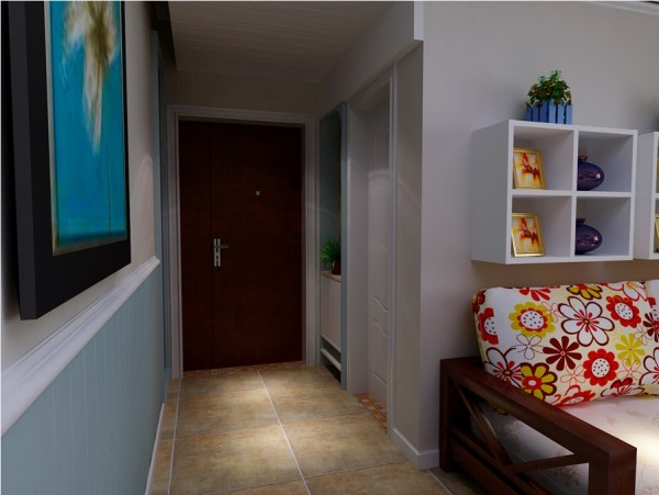 入户门的设计,采用墙面壁柜的形式来做的。