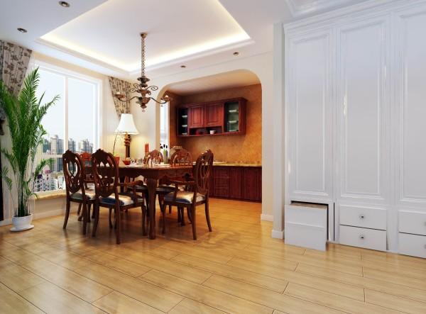 厨房做成开放式的,红木色的橱柜及餐桌椅,在欧式的风格基础上毫无违和感,反而增添了乡村气息。