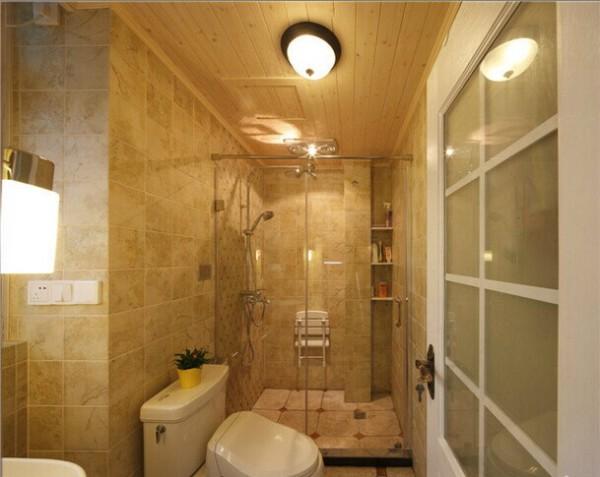 卫浴间里的七彩地砖和玻璃浴室非常相配。