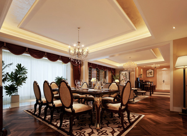 客厅与餐厅的结合,让视野更加开阔,同时也最大限度的开发 了空间使用率。餐桌在造型和色彩上紧随风格,餐桌是实木的,给人感觉很踏实,厚重感很强,采用描金处理,儒雅富丽,带有浓烈的欧式色彩。