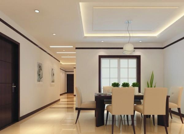 厅的设计有一丝中式的味道,餐桌的颜色与门套的颜色,脚线的颜色基本一致和谐而统一。