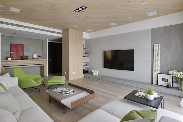客厅中央专门定制的神明桌,下方桌子可收起来,几乎不占用空间。    色彩搭配上使用三种不同的灰色带出层次感,清水模砖带出清爽质感,机柜则隐藏在侧面。