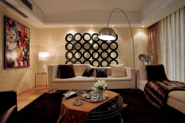 本案以柔和的米黄色为主题,深色为衬托,营造一个现代、简约而奢华的室内空间。整体设计手法极为简洁。