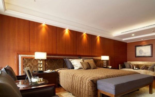 中信未来城-三居室-138.01平米-卧室装修设计   室内布置中也有既趋于现代实用,又吸取传统的特征,在装潢与陈设中溶古今中西于一体,例如传统的屏风、摆设和茶几,配以现代风格的墙面及门窗装修、新型的沙发;