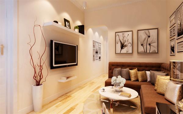 设计理念:客厅很小,所以要在小空间内将电视墙与小垭口做处理,细节彰显设计。 亮点:将垭口做造型,打破传统的长方形,弧度让现代风格增加了些许的温柔。