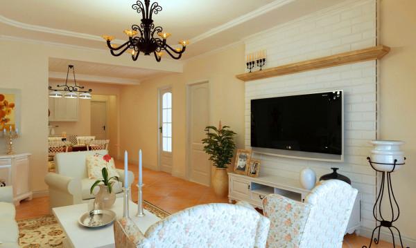 客厅的电视墙采用白色的文化石作为肌理效果,原木色的隔板摆放小小的烛台,地面的斜铺仿古砖,更增添了几分田园、接近自然和返璞归真的感觉。
