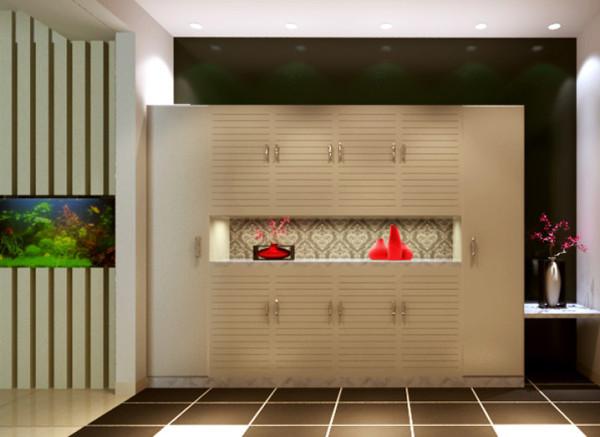 设计理念:入户花园改造成为储物装饰空间,兼具实用与装饰性,储物柜旁的隔板造型既可以摆放装饰品,也兼具实用性。入户花园地面采用深色仿古砖,在地面上区分空间。