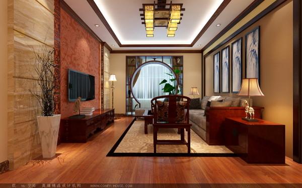 客厅电视背景墙的局部花梨木色镂空雕花的使用,以及沙发背景墙木线的使用,搭配中式沙发、家具,使整体空间感觉更加丰富,大而不空,厚而不重,有格调而又不显压抑。