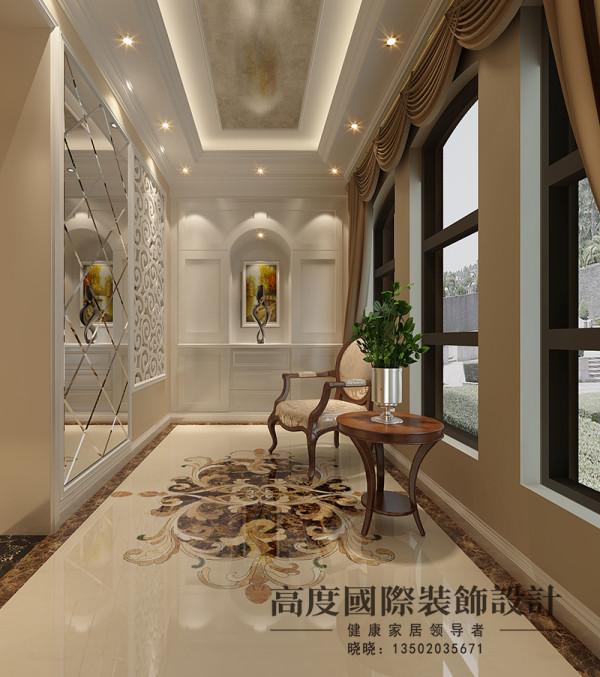 玄关处无论是装饰画的选择还是吊顶、地面拼花的选择都是很有特色的,包括地面拼花是专门定制的,墙面选用镂空的和车边境的结合,这样采光度比较好。