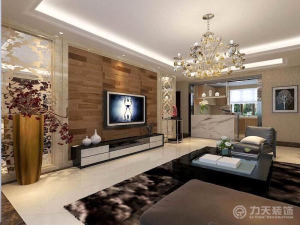 电视墙采用石材做的几个简单的几何造型,既简单又大方,再加上地板上墙和两侧贴花玻璃,配上顶部照下来的灯光,整个电视墙把客厅提升起来。