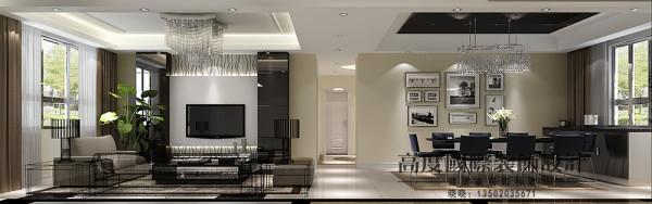 客厅风格以及造型是纯现代风格的,吊顶选用阶级吊顶,电视背景墙选用黑色的玻璃做点缀,给人一种超现代的感觉。