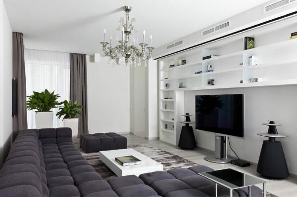 现代简约风格。颜色上面选择了黑白灰三种颜色。都是偏冷色调的。不知道的话会以为是单身男士的住所。
