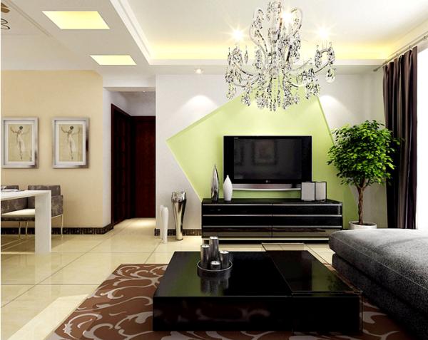 客厅的电视背景墙,运用了明快的青绿色装饰,在这炎炎的夏日给人一丝清爽的感觉,不规则的图形设计,色彩的对比效果,简洁而时尚,成为居室内的亮点。