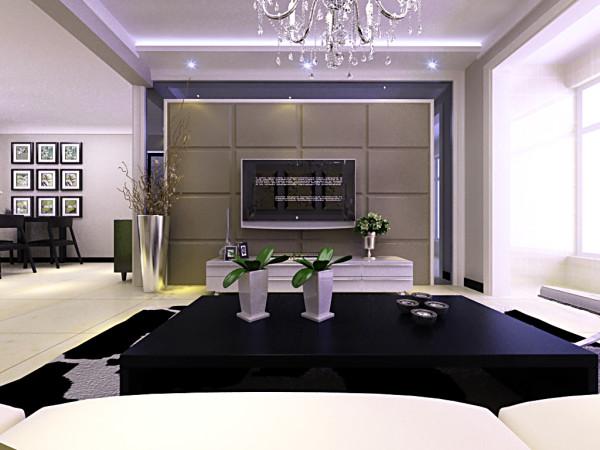 客厅不做过多造型,一切从简,电视墙上一条灯带,突出电视墙效果
