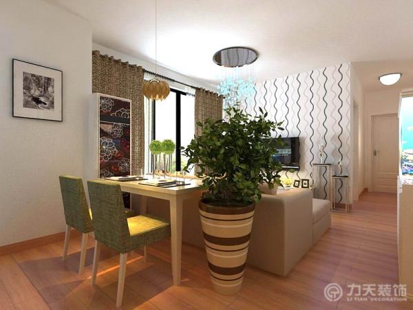 餐厅的餐桌选择了现代感极强的木质和布艺结合的两人餐桌,布艺颜色用的是和整体空间相呼应的比较清新的绿色,非常的简洁时尚