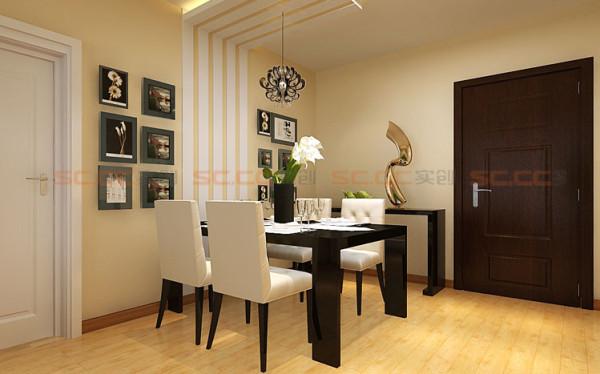 线性造型和客厅影视墙呼应,颜色的搭配营造温馨的就餐区域。立面衔接顶面造型搭配颜色的间隔勾划出餐厅区域,艺术吊灯的简单装饰。