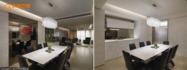 位于动线交会口,以白色烤漆串接与整合立面,并透过茶镜与餐柜设计,形构方整放大的餐厅尺度。