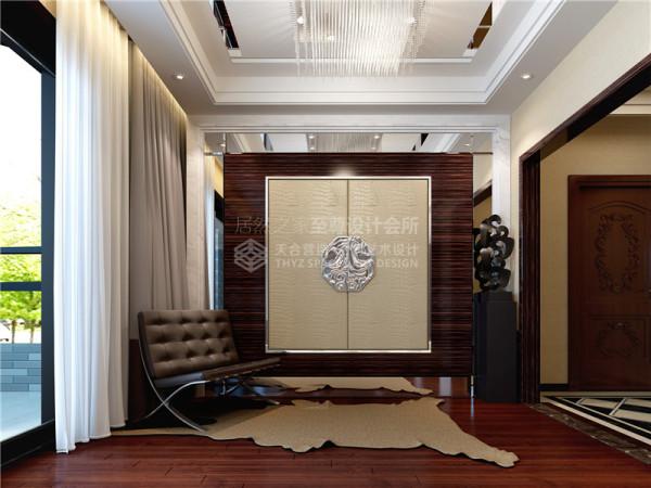 进门处设置玄关区域。作为人一进门的第一感受,玄关区域以装饰为主,为整体风格营造一种代入感的氛围。