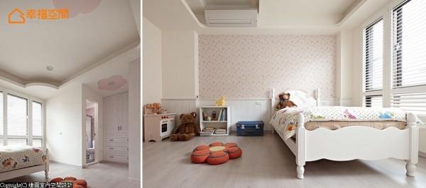 粉红色彩与白色腰板铺叙的女孩房中,天花缀以造型花朵呼应整体氛围,另在卫浴前规划更衣段落,让女孩的大量衣饰有充足收纳空间。