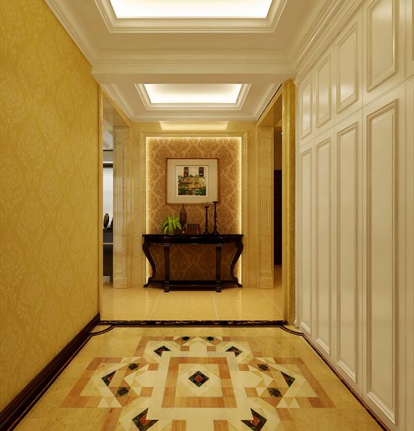 玄关地面的定制拼花经典图案开启一室的奢华高贵,彰显出住宅的华丽气质。向前行进步入大厅,开阔的客厅与餐厅,构成公共的空间,大面的开窗引入户外自然风景,使室内氛围更显优雅惬意。