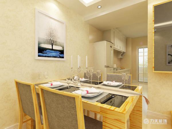 在客厅的另一边放了一个小型的餐桌,在厨房的设计上,也采用了开放式的样式,这样的设计有利于空间光感的投入,也有利于拓宽空间感。