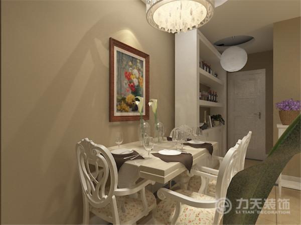 餐厅的背景通过照片墙和餐边柜的表现形式,配以造型灯池。增加餐厅的品味提升。