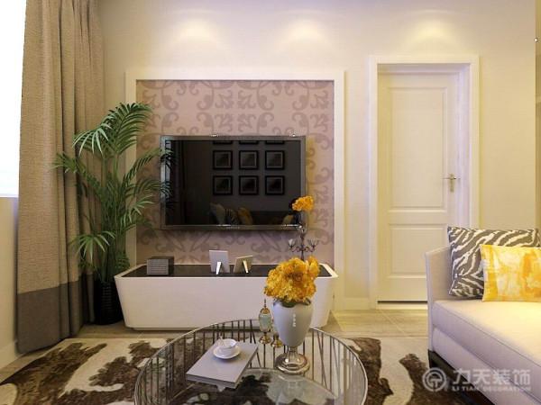 电视背景墙采用了简洁的石膏线条与灰棕色壁纸搭配作为装饰,做到了简洁时尚
