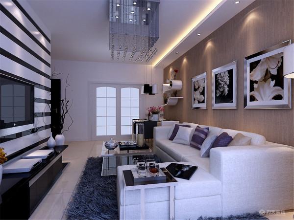 沙发背景是三幅现代画,简单不高调,客厅主灯是客厅的重心,水晶灯显得大气高贵。