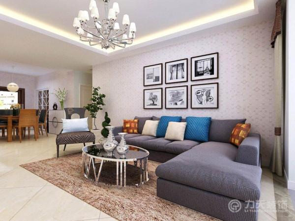 客厅的电视背景墙采用了白色生态木的护墙板作为装饰,余下墙面部分刷了淡黄色乳胶漆,简单大气。