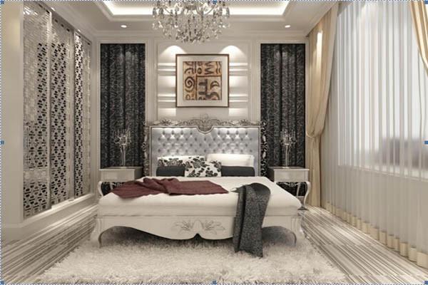 卧室空间的设计白色的软包背景墙,配套欧式床品,高端奢华,银灰色调,黑白灰运用,米色窗帘温馨中夹杂神秘高贵奢华的气息