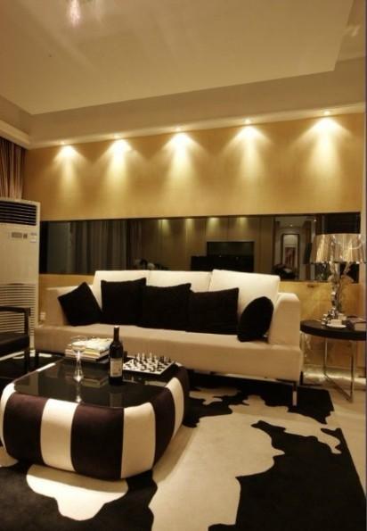 咖色为主色调,镜面背景墙的搭配,增加了空间的整体视觉效果。